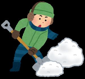 雪かきスコップで雪かきをする人