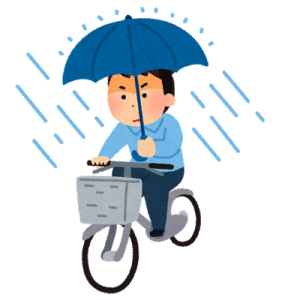 雨の日に傘を差しながら自転車に乗る男性