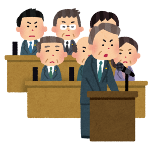議会で質問をする市議会議員